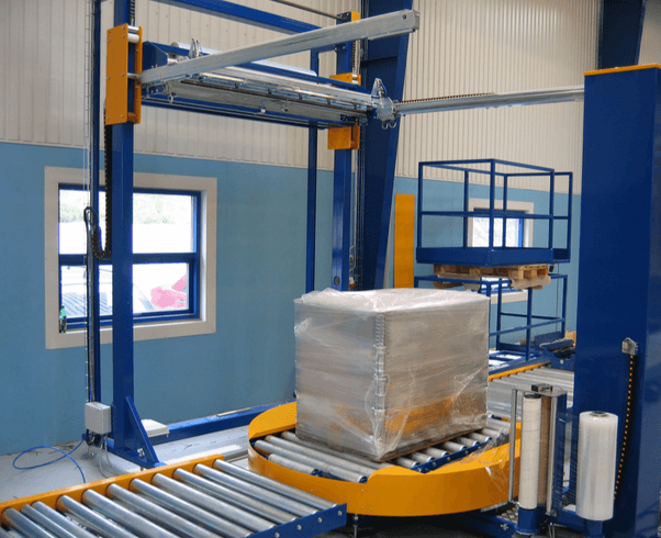 Inline pallet stretch wrapping machine for pallet wrapping and top film sheet dispenser