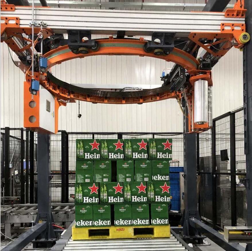 High speed orbital ring pallet and skid stretch wrapping machine