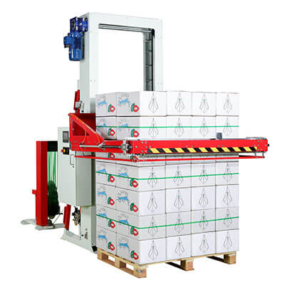 Horizontal baler strapping pallet and skid loads in horizontal direction